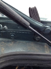 Loop installed under bolt in the trunk